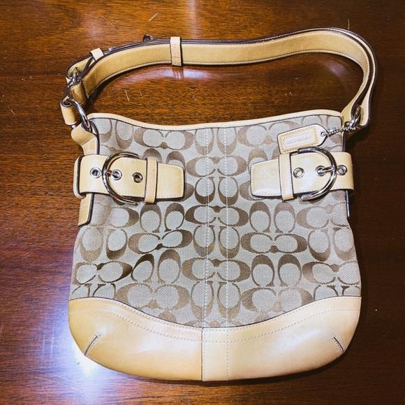 couch Handbags - Coach Signature Soho Duffle handbag